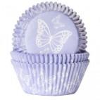 Cápsulas de mariposas blancas con fondo lila. HoM.